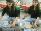 बिना बेलन के रोटी बेल रही है लड़की, वीडियो हुआ वायरल