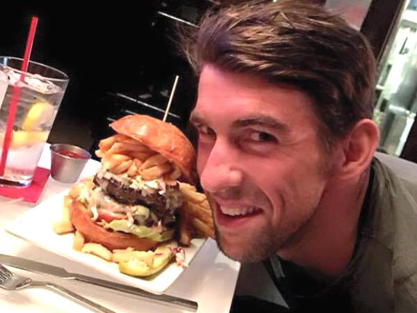 Michael Phelps eating Burger