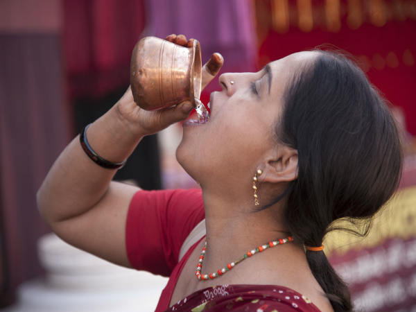 Why You Shouldn't Stand and Drink Water, According to Ayurveda