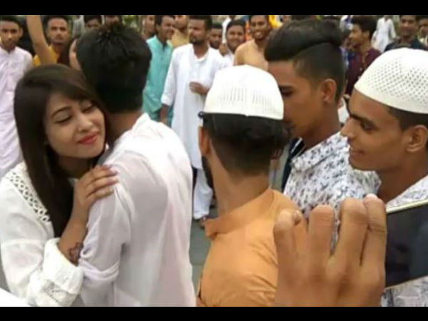 Teen girl offers hugs to boys in public with elan for Eid Milan