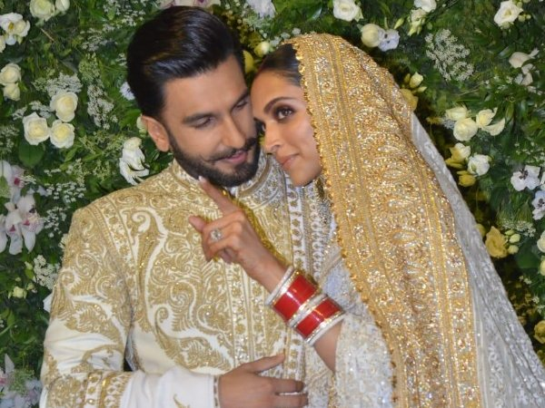 Deepika Padukone and Ranveer Singh dazzles in matching gold and white outfits at Mumbai reception.