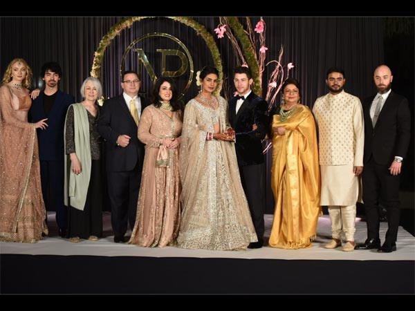 Of Intricate Motifs & Velvet, Priyanka & Nick Make An Adorable Couple At Their Delhi Reception
