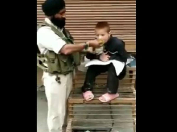 crpf-personnel-havaldar-iqbal-singh-feeds-paralytic-child-in-srinagar