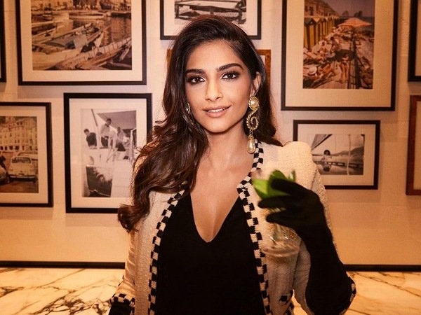 Sonam Kapoor Ahuja Black Velvet Dress And White Jacket Look