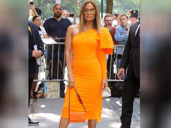 Nora Fatehi And Jennifer Lopez Wore Orange Alex Perry Dress