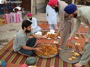 Pakistani Sikhs Serving Iftar Their Muslims Brethren