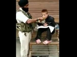 Crpf Personnel Havaldar Iqbal Singh Feeds Paralytic Child In Srinagar