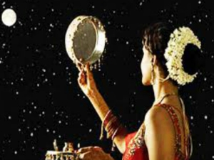 Karva Chauth Vrat Women Look At Moon Through Sieve To Break Fast