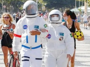 Brazilian Couple Wear Spacesuits To Fight Covid