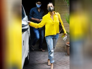 Malaika Arora Looks Beautiful In Yellow Shirt And Jeans
