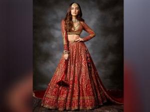 Shraddha Kapoor Unveils The Elegant Veil Look In Falguni Shane Peacock Red Bridal Lehenga