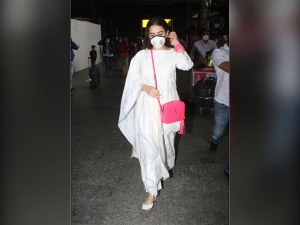 Sara Ali Khan In Latest Ivory Chikankari Suit Airport Look