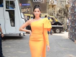 Nora Fatehi Looks Stunning In One Shoulder Orange Dress