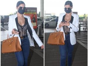 Nora Fatehi Wore White Blazer And Semi Sheer Corset Top In Airport Look